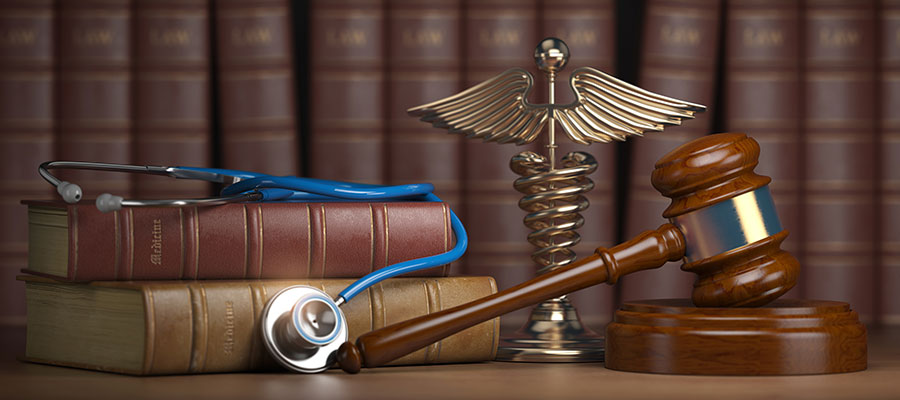 gavel stethoscope caduceus and law books
