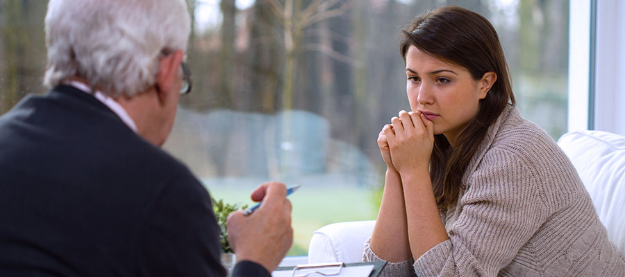 concerned woman speaking with a counsellor