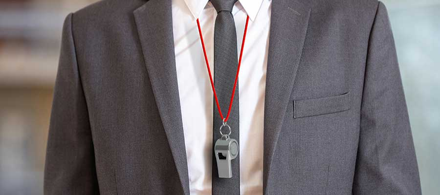 business coach wearing a whistle