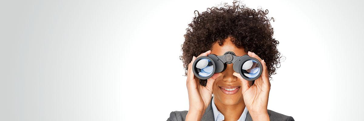 woman looking through binoculars vision future